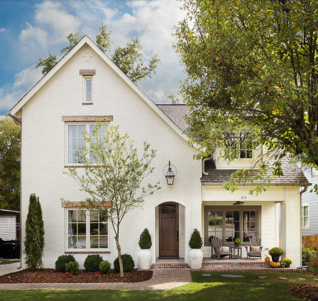 Limewash vs painted brick exterior plank and pillow - Pros and cons of painting exterior brick ...